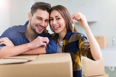 Image of happy couple with keys in hand