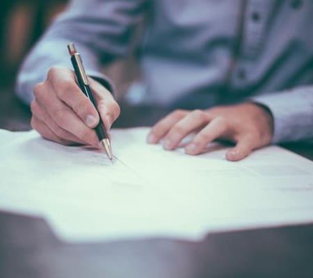 man-writing-on-documents