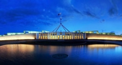 Sunset image of parliament house in Canberra.